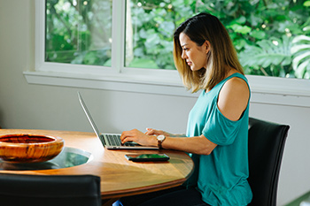 Woman using Online Customer Service Center with laptop