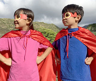 Kids wearing the Maka mask and cape